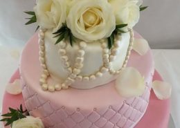 Pink three-tier quilted wedding cake with white roses - Tamworth west midlands