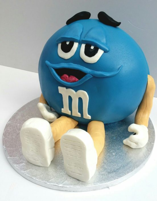 Blue M&M sculpted surprise cake - - Quality Cake Company Tamworth