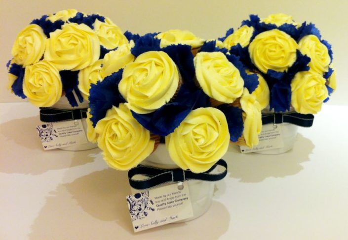 Wedding bouquet cupcake centre pieces cream and blue - Quality Cake Company Tamworth