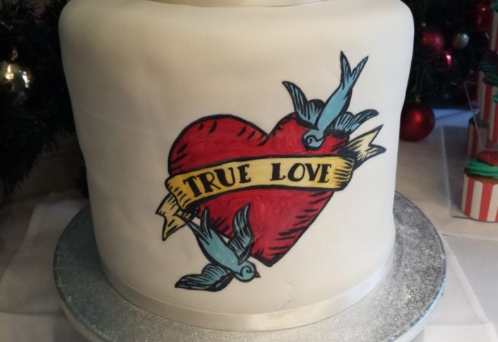 """True Love"" detail on front of Tattoo Wedding cake - Quality Cake Company Tamworth"