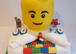 Lego head birthday cake - Quality Cake Company Tamworth