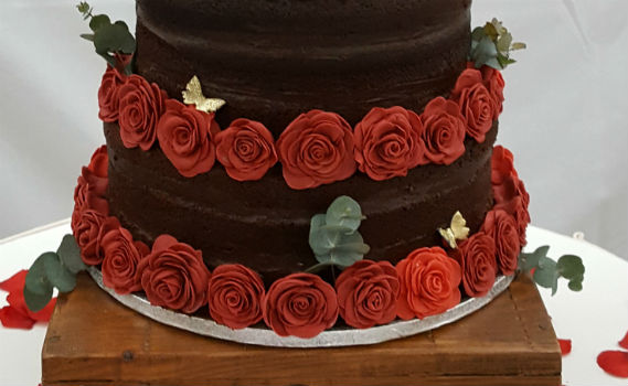 Naked chocolate wedding cake handmade icing red roses - Tamworth