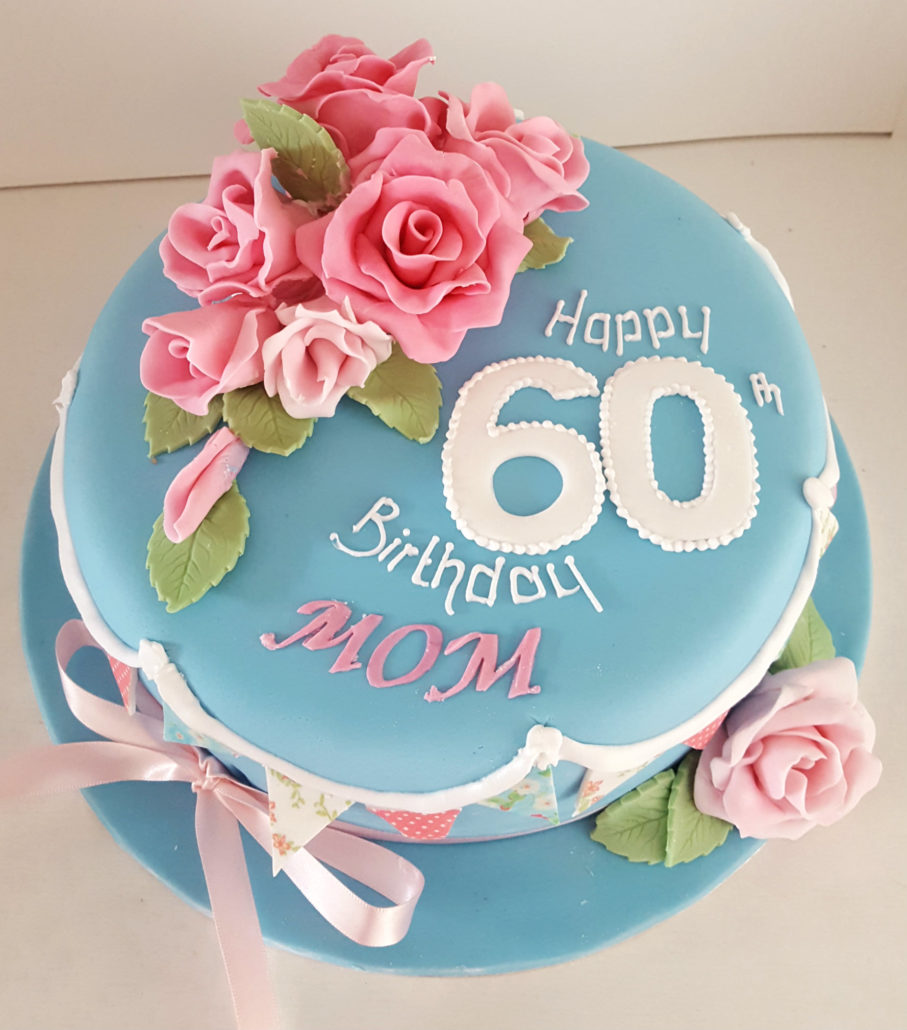 Pink Flowers On Blue Birthday Cake