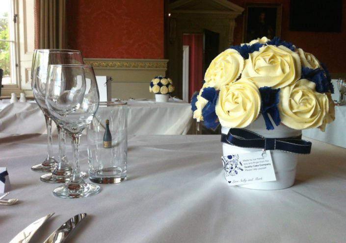 Cream and blue wedding centrepieces