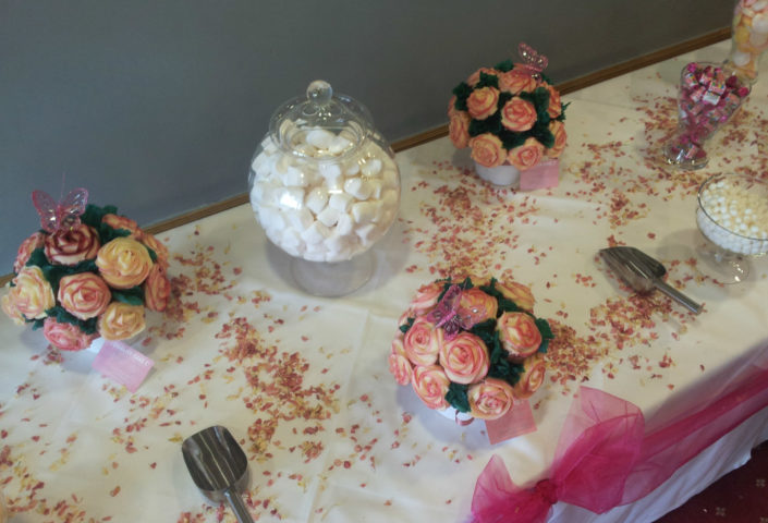 pink and cream wedding cupcake centrepieces on a sweet table - tamworth west midlands