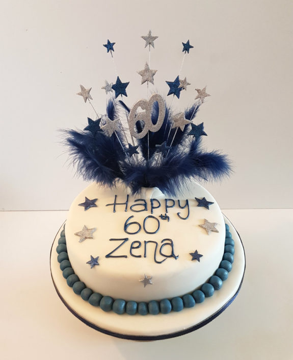 Blue white feathers stars birthday cake