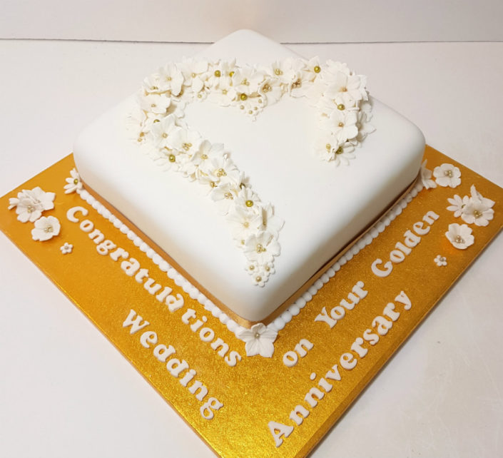 Golden 50th anniversary celebration cake white flowers tamworth