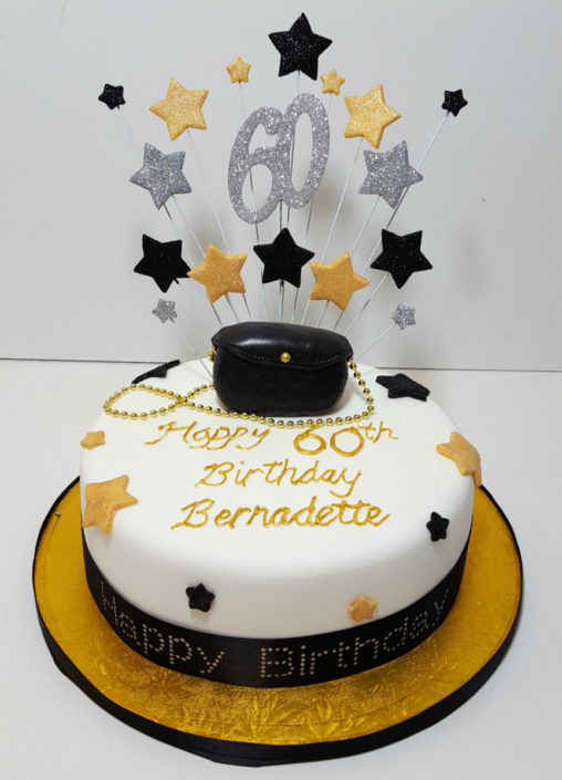 Gold & black stars handbag cake
