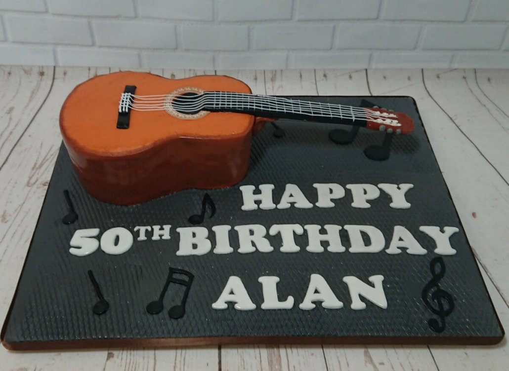 Acoustic guitar sculpted novelty cake - Quality Cake Company Tamworth