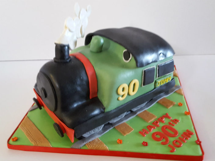 Sculpted train birthday cake
