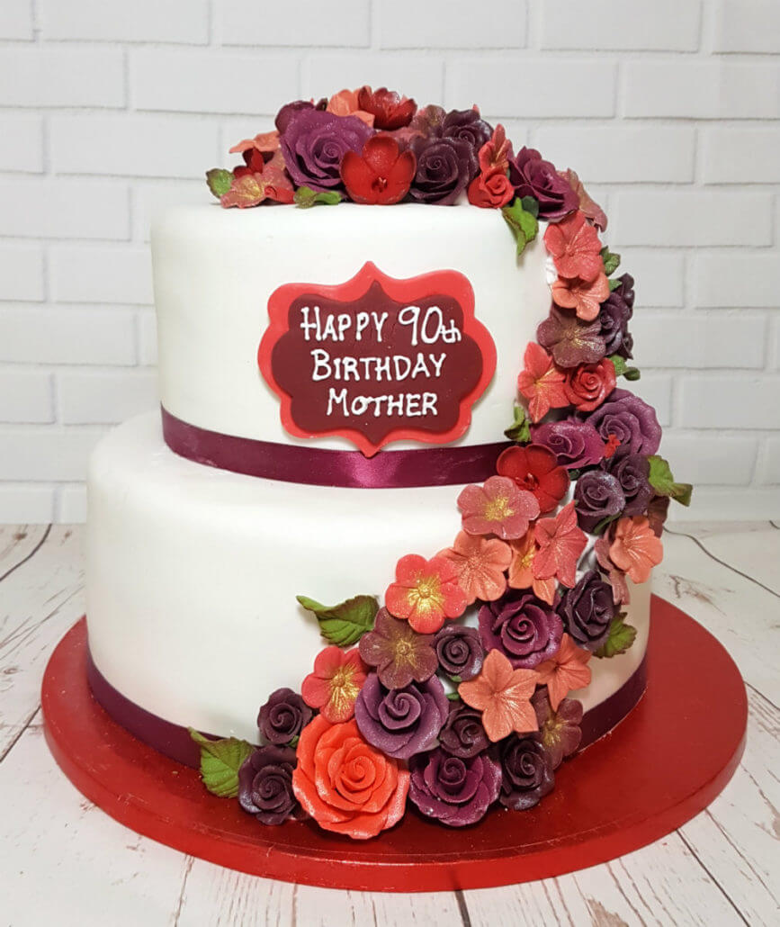 Two Tier Red And Burgundy Flower Spray Birthday Cake