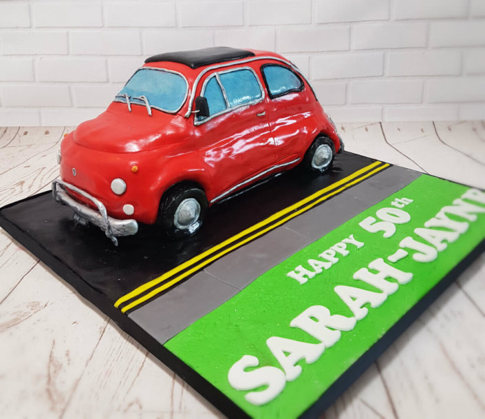 classic fiat 500 on the road scultped novelty cake - tamworth sutton coldfield