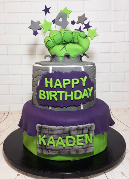 Two tier hulk theme cake with hulk hand topper - tamworth sutton coldfield