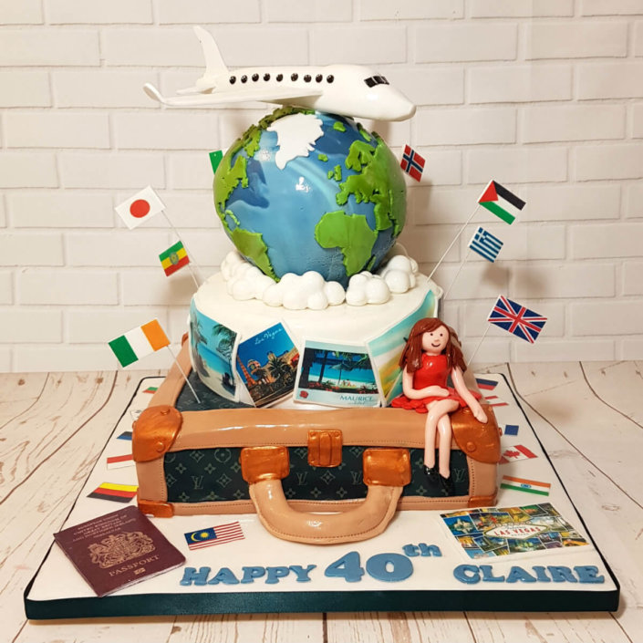 Tiered travel theme cake with 3d globe earth and areoplane - tamworth