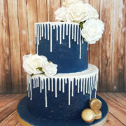Two tier blue and white drip wedding cake - Quality Cake Company Tamworth