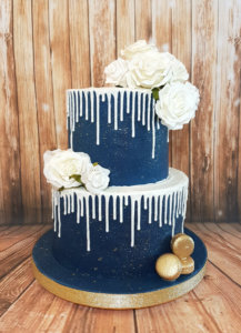 Two Tier Blue And White Drip Wedding Cake