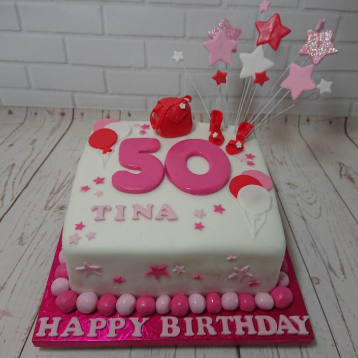 Bright pink star spray 50th birthday cake - Tamworth