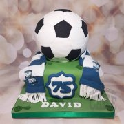 Large football and scarf novelty cake