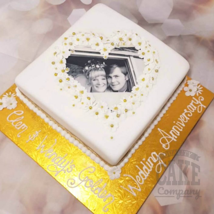Golden 50th wedding anniversary cake floral photo - tamworth