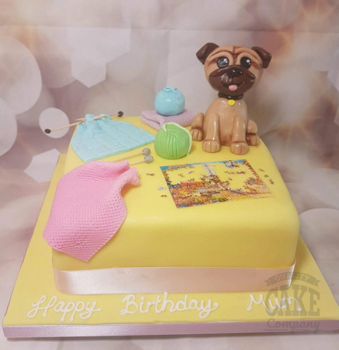 Pug figure with knitting and puzzles cake - tamworth