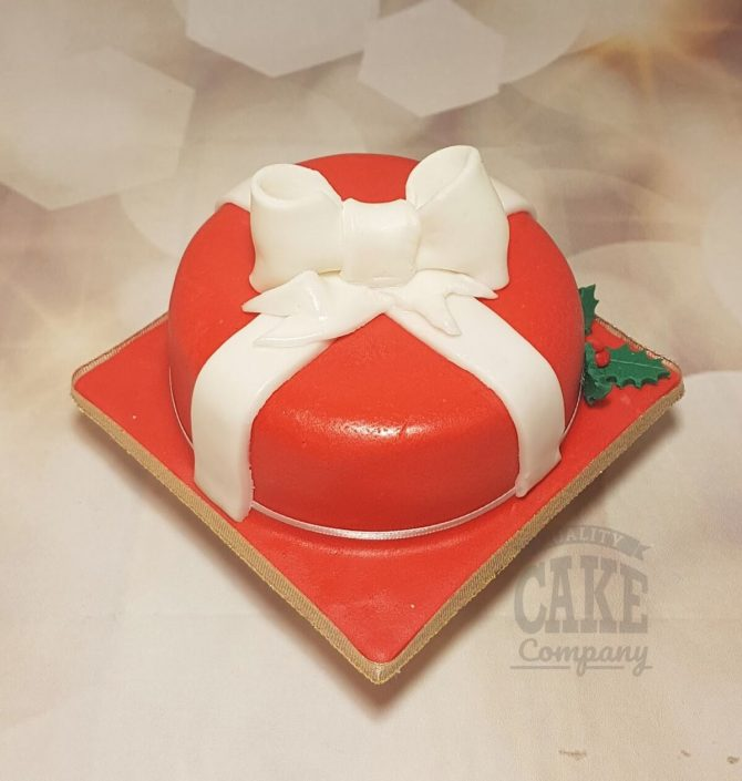 Red christmas present cake white bow - tamworth