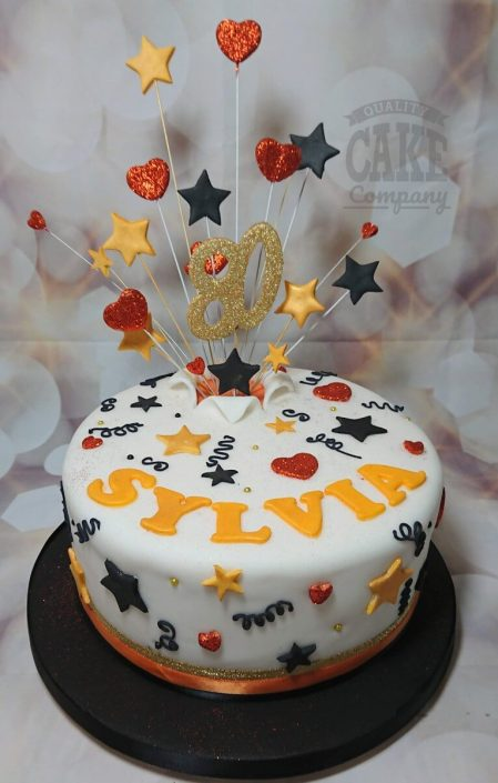 Copper blacks golds star spray cake - tamworth