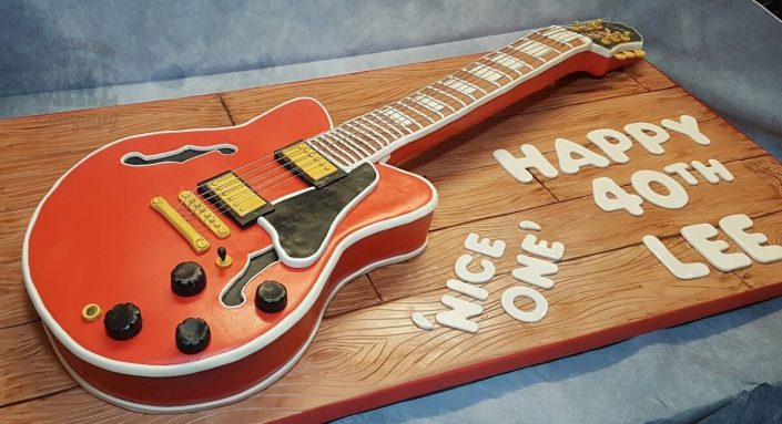 Lifesize replica guitar sculpted novelty cake - Tamworth West Midlands