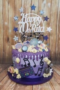 Purple drip cake with music theme and custom topper - Tamworth West Midlands
