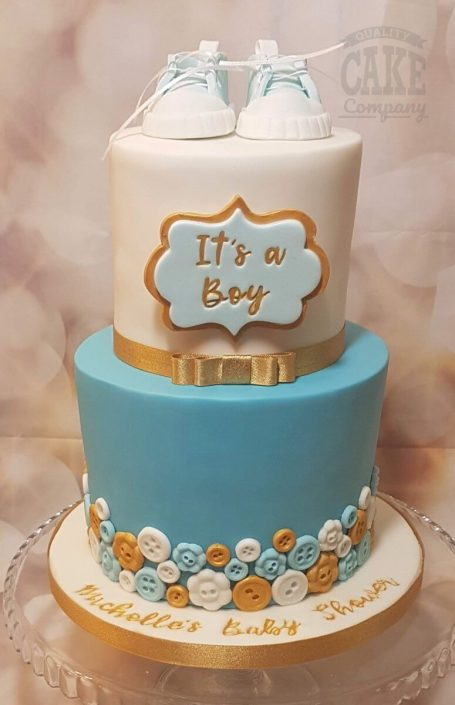Two tier its a boy baby shower cake with buttons and booties - Tamworth West Midlands