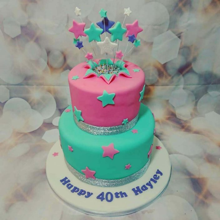 Two tier turquoise pink star spray birthday cake - Tamworth West Midlands