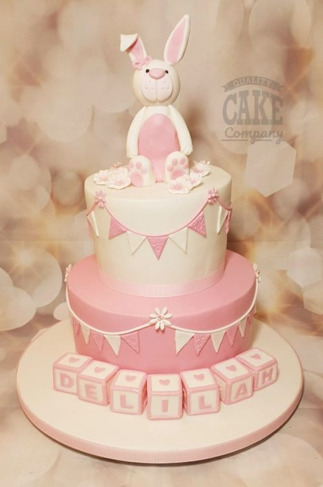 Two tier cute christening bunny blocks and bunting cake - Tamworth