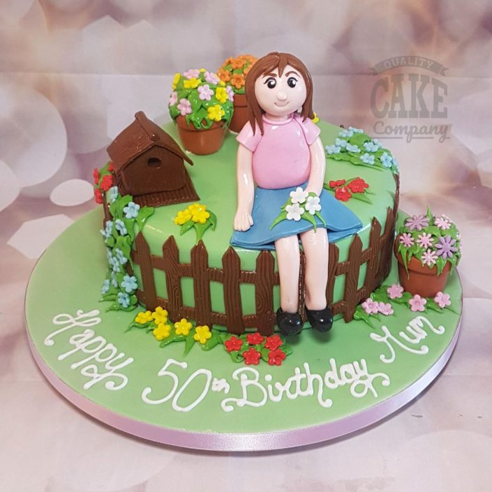 Girl sitting in garden birthday cake - Tamworth
