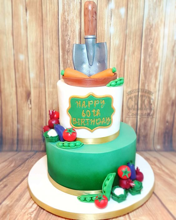 Two tier modern gardening theme cake with trowel and vegetables - Tamworth