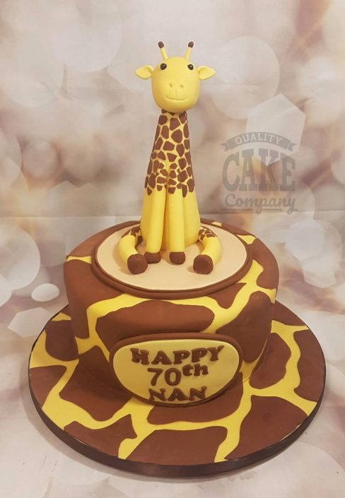 Cute giraffe icing figure sitting on giraffe print cake - Tamworth Sutton Coldfield