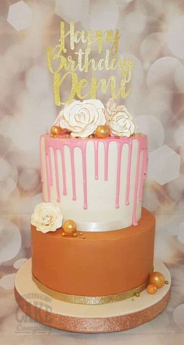 Two tier rose gold drip cake with custom topper - tamworth