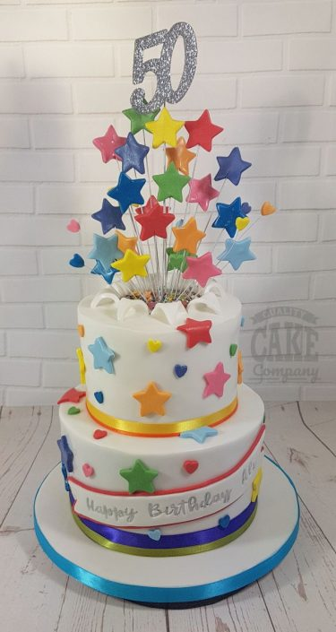 Two tier rainbow theme star spray cake - tamworth