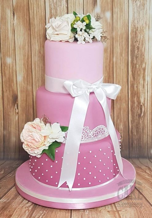 Three-tier colourful wedding cake pink ombre with white flowers and details - tamworth