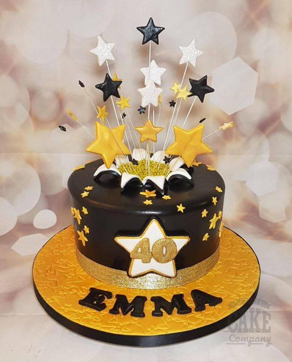 black and gold star burst birthday cake - celebration cake tamworth