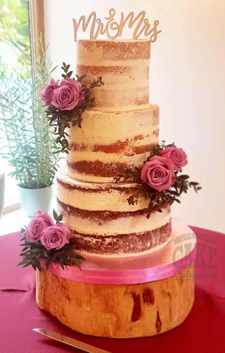 Three tier semi naked wedding cake with pink roses and mr & mrs topper - mythe barn tamworth west midlands