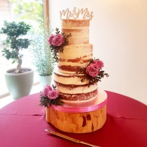 Three tier semi naked rustic wedding cake with pink roses and mr & mrs topper - mythe barn tamworth west midlands