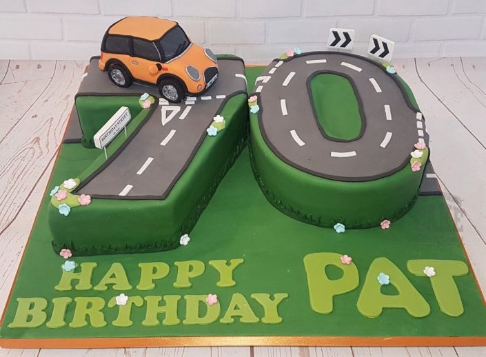 70th birthday number cake with orange mini cooper on the road - tamworth