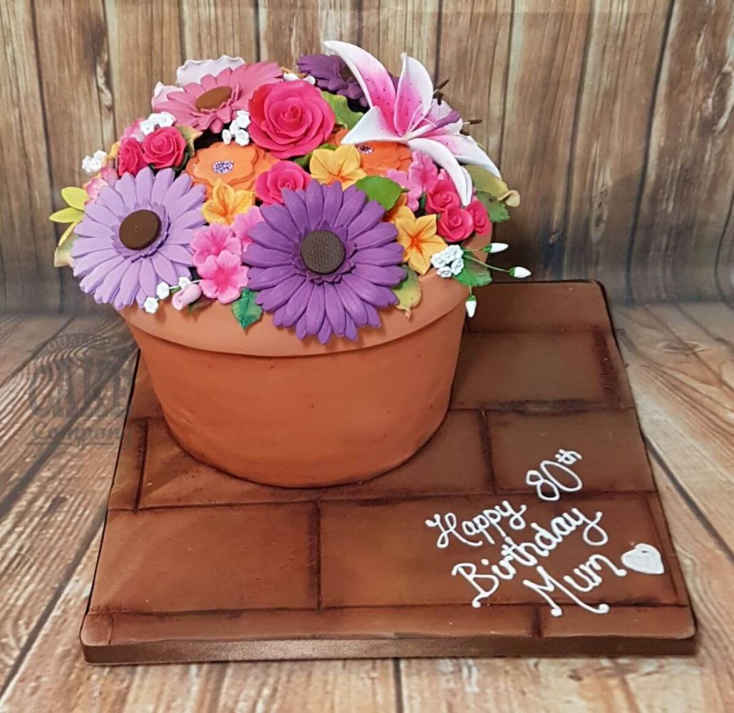 Bright and colourful flower pot novelty cake - tamworth