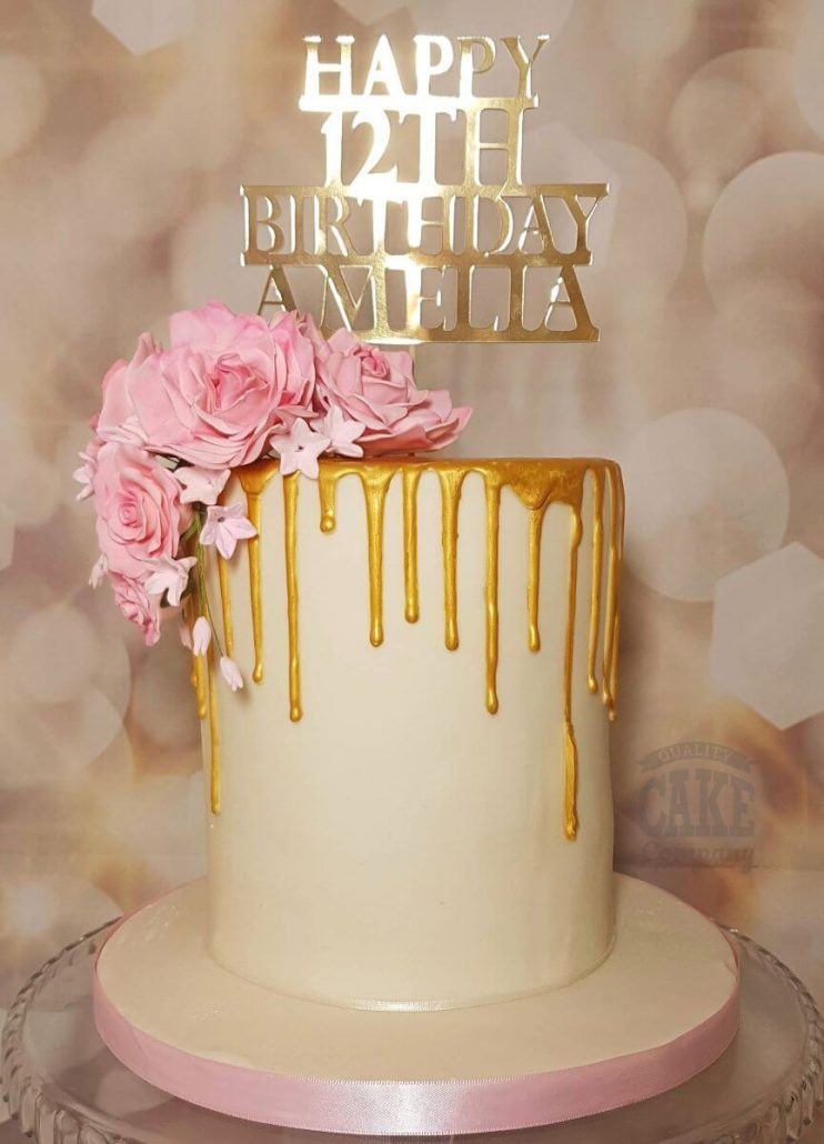 Elegant gold drip cake with pink roses and personalised topper - tamworth