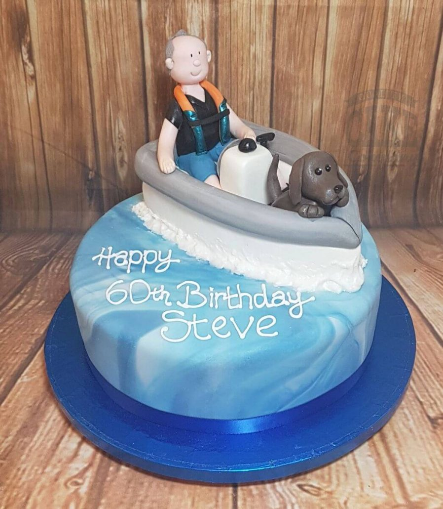 Man and dog in a boat on sea cake - tamworth