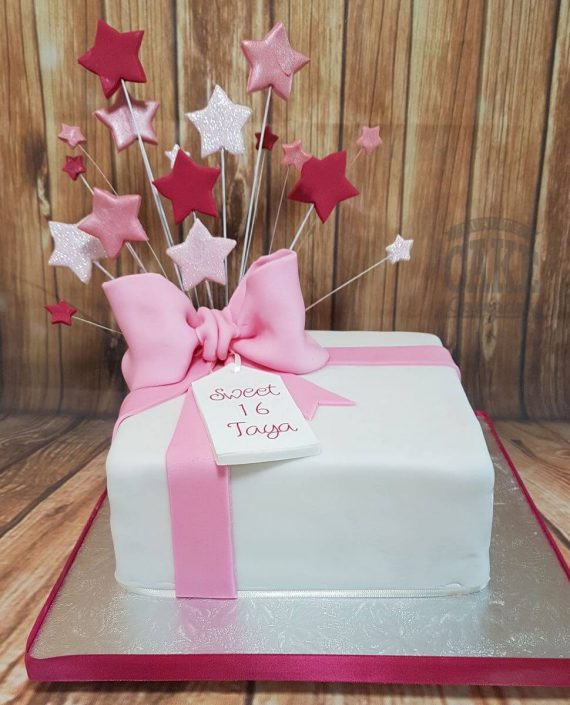 Simple white pink present star spray birthday cake - tamworth