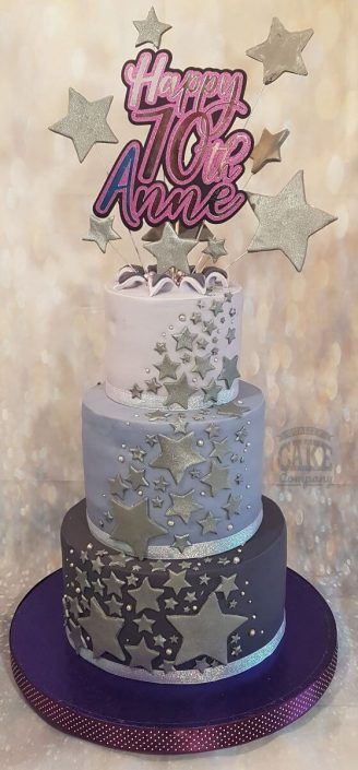 Three tier purple star burst birthday cake 70th birthday - tamworth