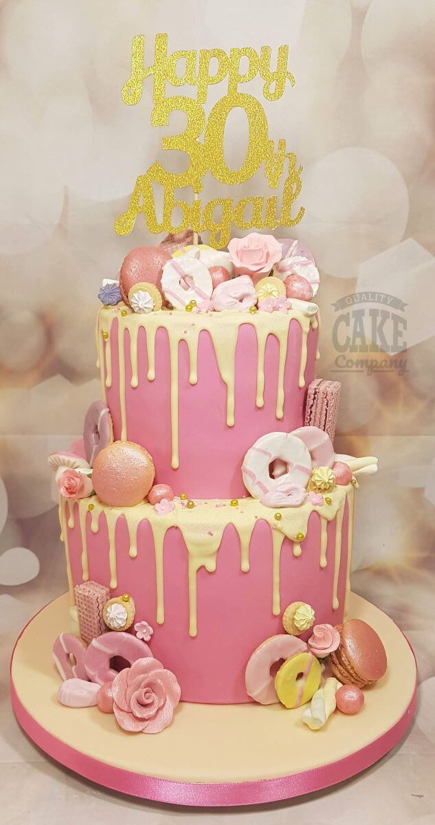 two tier pink sweetie drip cake with personalised cake topper - tamworth