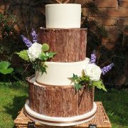 four tier rustic wedding cake with bark effect and wild flowers - tamworth west midlands