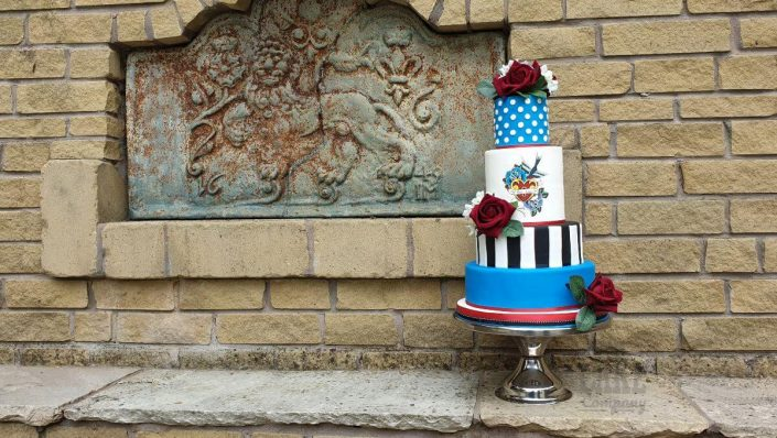 four tier modern rockabilly wedding cake - bright blue, red roses - tamworth, west midlands