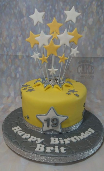yellow and silver theme star spray cake - tamworth